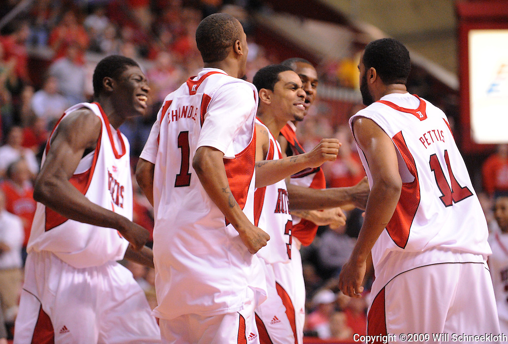 Mar 7, 2009; Piscataway, NJ, USA; Rutgers guard Earl Pettis (11) is congratulated by teammates after scoring a basket to put Rutgers up by 3 points with only seconds remaining in the second half of Rutgers' senior day game against South Florida at the Louis Brown Athletic Center.  Rutgers won 45-42.