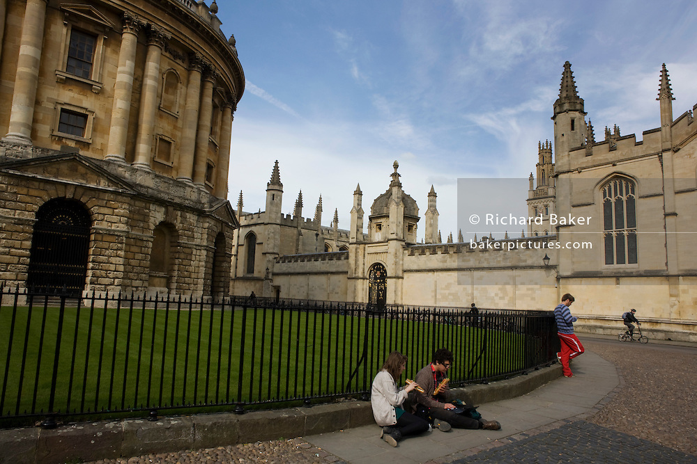 Oxford University Students and Radcliffe Camera 150 feet (46 meters) above cobbled Radcliffe Square.