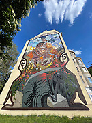 House Art, Austria. Vienna. When his six-year-old mural 'Dissection of a Polar Bear' started to crumble, Viennese artist Nychos decided to replace it with a fresh motif: a translucent embracing couple with elements from Viennese Jugendstil (Art Deco), creating an entrance door to Vienna's 10th city district Favoriten.