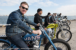 Thompson Cycles's Bryan Thompson with his custom 1955 Triumph Pre-Unit at the docks where it was picked up with all of the invited builder's bikes for the Mooneyes show. Yokohama, Japan. Saturday December 2, 2017. Photography ©2017 Michael Lichter.