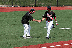 26 April 2014:   Umpire Bret Bruington, catcher Matt Jones and batter Paul DeJong who hits a home run over the fence in right field and rounds the bases during an NCAA Division 1 Missouri Valley Conference (MVC) Baseball game between the Southern Illinois Salukis and the Illinois State Redbirds in Duffy Bass Field, Normal IL