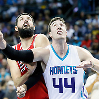 03 November 2015: Chicago Bulls forward Nikola Mirotic (44) vies for the rebound with Charlotte Hornets center Frank Kaminsky III (44) during the Charlotte Hornets  130-105 victory over the Chicago Bulls, at the Time Warner Cable Arena, in Charlotte, North Carolina, USA.