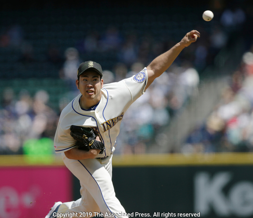 Seattle Mariners starting pitcher Yusei Kikuchi works against the Minnesota Twins during a baseball game, Sunday, May 19, 2019, in Seattle. The Mariners went on to win 7-4. (AP Photo/John Froschauer)