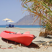 Red kayak in Plakias beach on Crete
