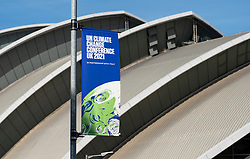 Glasgow, Scotland, UK. 21st October 2021. Final preparations underway at the site of the UN Climate Change Conference COP26 to be held in Glasgow from Oct 31st. Pic; A COP26 banner in front of the Armadillo venue.  Iain Masterton/Alamy Live News.