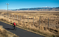 A cyclist cruises along the pathway between Highway 89 and the National Elk Refuge on Sunday afternoon. Users are reminded the five-mile segment of the pathway between Flat Creek and the Gros Ventre River closed today to reduce impacts on migrating wildlife that winters on the refuge.