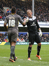Leicester City's Kasper Schmeichel thanks team mate Liam Moore for a great tackle - Photo mandatory by-line: Robin White/JMP - Tel: Mobile: 07966 386802 21/12/2013 - SPORT - FOOTBALL - Loftus Road - London - Queens Park Rangers v Leicester City - Sky Bet Championship