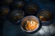 Pots of curry at Babu Shahi Bawarchi, New Delhi, India<br /> The famous but modest takeaway housed in the grounds of a shrine is famous for its biryani and whose owners ancestors served as chief cooks under the Moghul Emperor, Shah Jahan
