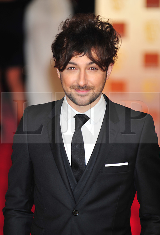 © Licensed to London News Pictures. 12/02/2012. London, England. Alex Zane arrives for the Orange British Academy Film Awards at The Royal Opera House on February 12, 2012 in London, England. Photo credit : ALAN ROXBOROUGH/LNP