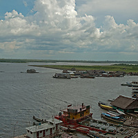 Houseboats, working boats and other ships crowd docks along the Amazon River in Iquitos, Peru.
