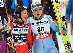 World Champion Lindsey Van of USA and third placed Anette Sagen at Ski Jumping ladies Normal Hill Individual of FIS Nordic World Ski Championships Liberec 2008, on February 20, 2009, in Jested, Liberec, Czech Republic. (Photo by Vid Ponikvar / Sportida)