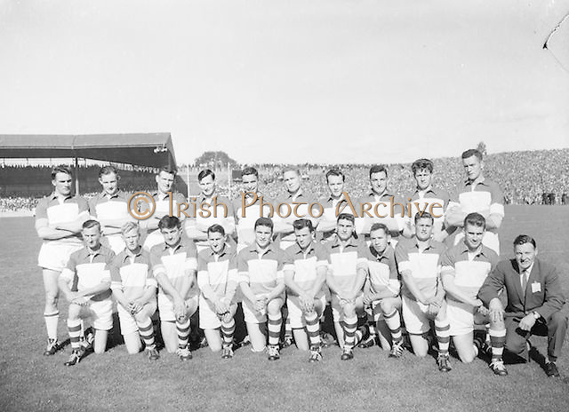 Offaly team before the All Ireland Senior Gaelic Football Final Down v. Offaly in Croke Park on the 24th September 1961. Down 3-6 Offaly 2-8.<br /> Back row (from left) Greg Hughes, Peter Dunne, Mick Casey, Charlie Wren, Phil O'Reilly, Sean Ryan, Mick Brady, Frank HIggins, Frank Weir, Sean Foran. <br /> Front row (from left) Larry Fox, Donie O'Hanlon, Har Donnelly, Tommy Greene, Willie Nolan, Tommy Cullen, Peter Daly, Sean Brereton, Paddy McCormick, Johnny Egan, Peter O'Reilly (trainer). .Subs: K. O'Neill for P. Rice; Rice for G. Lavery.