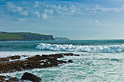 Cliffs of Moher and white horses waves and rocks from Doolin, County Clare, West Coast of Ireland
