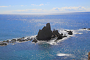 View over Mediterranean sea and rocks of Arrecife de las Sirenas, Cabo de Gata natural park, Nijar, Almeria, Spain