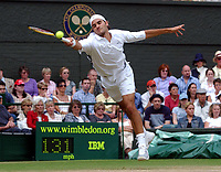 Roger Federer (Switzerland) during his Semi-Final win over Andy Roddick (USA) Wimbledon Tennis Championship, Day 11, 4/07/2003. Credit: Colorsport / Matthew Impey DIGITAL FILE ONLY