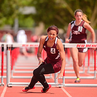 050915  Adron Gardner<br /> <br /> Ramah Mustang Taea Hill falls in pain at the final hurdle of the girls 2A hurdles final during the New Mexico state track meet in Albuquerque Saturday.