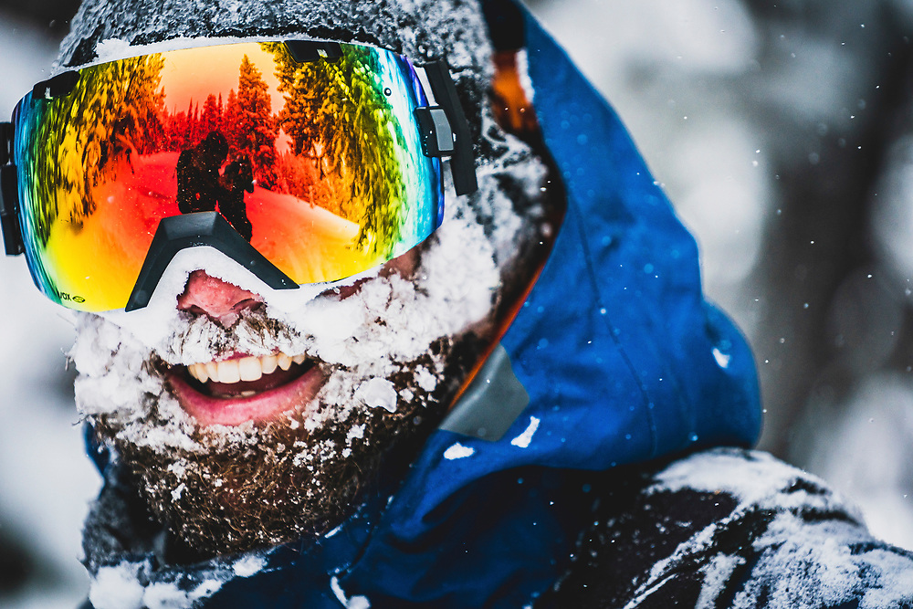 A late Jaunuary storm brings much needed snow to the Wasatch Mountains and puts a smile on Mike Quigley's face, Brighton backcountry, Utah.