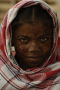 Mahafaly woman (Those-who-make-taboos) wearing sandalwood face paste to protect from the sun and as a beautification. Ampanihy, south-west coast of MADAGASCAR<br />