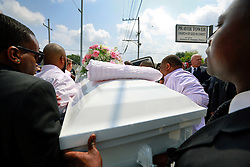 14 September 2013. Prayer Tower Church of God in Christ. New Orleans, Louisiana. <br /> Pall bearers carry the coffin of 11 yr old Arabian 'Ray Ray' Gayles, fatally shot September 2nd. Arabian was cradling a 1 yr old cousin whilst sat on the couch at home when gunmen pulled up outside and sprayed the house with bullets. Arabian was hit in the head and died shortly afterwards. NOPD is questioning 2 men in connection with the murder.<br /> Photo; Charlie Varley