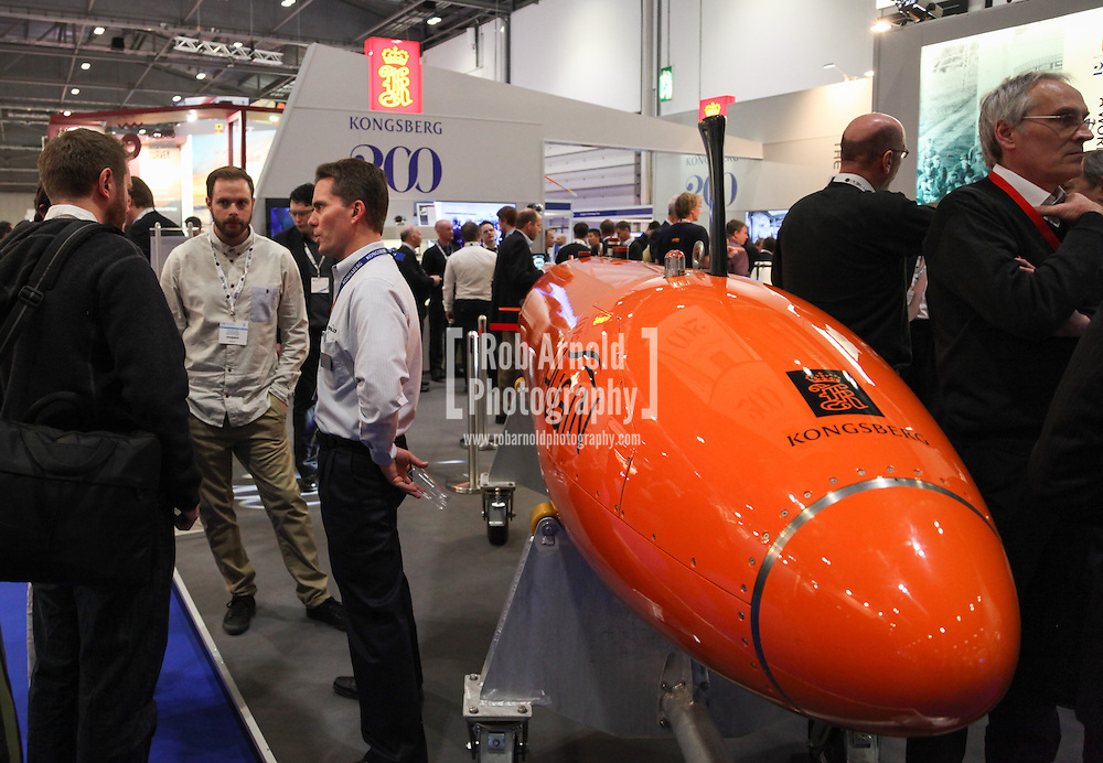 © Rob Arnold 11/03/2014. London, UK. A Hugin Autonomous Underwater Vehicle (AUV) at Oceanology International (OI), the world's largest exhibition for marine science and technology, held at London's ExCeL Centre. The three day exhibition provides an opportunity for industry, academic and government organisations to share knowledge and promote improvements in technology and strategy used for operating, surveying, protecting and exploiting resources in the oceans of the world. Photo Credit : Rob Arnold