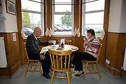 A couple eating a late breakfast at the Half Way Cafe on the A12 on the 26th October 2009 in Darsham in the United Kingdom.