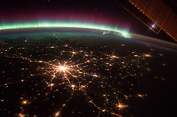 October 6, 2015 - Earth Atmosphere - The International Space Station crew witness nightly scenes of our Earth's beauty after performing their duties. Here on October. 6, 2015, framed by the edge of a huge Station solar panel, the city of Moscow, Russia sparkles in the night with spoke streets streaming out across the land while an aurora of blue, white and purple contrast the star-filled sky. (Credit Image: ? Scott Kelly/NASA via ZUMA Wire/ZUMAPRESS.com)