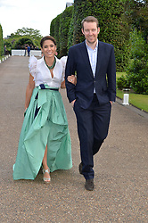 JAMES & LILY HODGES at The Ralph Lauren & Vogue Wimbledon Summer Cocktail Party at The Orangery, Kensington Palace, London on 22nd June 2015.  The event is to celebrate ten years of Ralph Lauren as official outfitter to the Championships, Wimbledon.