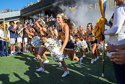 Sep 11, 2021; Morgantown, West Virginia, USA; West Virginia Mountaineers cheerleaders lead the team out prior to their game against the Long Island Sharks at Mountaineer Field at Milan Puskar Stadium. Mandatory Credit: Ben Queen-USA TODAY Sports