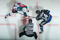 KELOWNA, CANADA - DECEMBER 30: Linesman Dave McMahon stands at the face off between Kyle Topping #24 of the Kelowna Rockets and Eric Florchuk #14 of the Victoria Royals on December 30, 2017 at Prospera Place in Kelowna, British Columbia, Canada.  (Photo by Marissa Baecker/Shoot the Breeze)  *** Local Caption ***