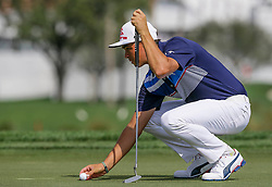 February 25, 2017 - Florida, U.S. - Rickie Fowler sizes the first green during the third round of the 2017 Honda Classic Saturday February 24, 2017 at PGA National in Palm Beach Gardens. (Credit Image: © Bill Ingram/The Palm Beach Post via ZUMA Wire)