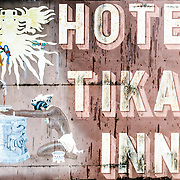 Weathered sign of the Hotel Tikal Inn, one of the free lodging options within the Tikal National Park in the jungles of northern Guatemala.