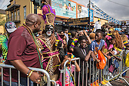 Gralen Banks in his Zulu Krewe suit as the Zulu parade winds down on Mardi Gras day in New Orleans.