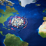 Microplastics from a manta trawl in the Sargasso Sea ocean gyre are placed on a map of the area as a visual demonstration.