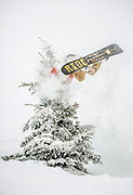 """SHOT 1/24/16 1:21:26 PM - Alex Mlynarek of Salt Lake City, Utah clips a tree at Brighton Ski Resort. Brighton is a ski area located in Big Cottonwood Canyon, 30 miles (48 km) from downtown Salt Lake City, Utah. Brighton Ski Resort was the first ski resort in Utah, and one of the first in the United States. Brighton was started in 1936 when members of the Alpine Ski Club built a rope tow from wire and an old elevator motor. Brighton claims to be a """"no-frills"""" resort whose sole business is to provide skiers and snowboarders with top-notch trails. Brighton is also known for its extensive backcountry access, visitors can purchase single ride lift tickets to reach the backcountry access gates at the top of the resort. Although the terrain inbounds at Brighton can rival that of the backcountry, Brighton is known for its cliffs, chutes, bowls and natural features. (Photo by Marc Piscotty / © 2016)"""