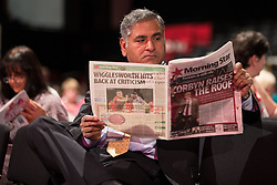 © Licensed to London News Pictures . 30/09/2015 . Brighton , UK . A delegate at the conference reads a copy of the Morning Star with Jeremy Corbyn featured on the front page . The 2015 Labour Party Conference . Photo credit : Joel Goodman/LNP