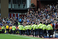 police run to the away fans after some Chelsea supporters invade the pitch after Frank Lambard scores his 2nd goal. Barclays Premier League, Aston Villa v Chelsea at Villa Park in Birmingham on Saturday 11th May 2013. pic by Andrew Orchard,  Andrew Orchard sports photography,