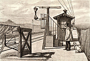 French postal service. Mail train approaching a railway station platform fitted with apparatus for catching sacks of mail from the moving train.  Engraving from 'Le Journal de la Jeunesse' (Paris, 1886).