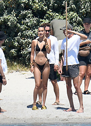 EXCLUSIVE: Bella Hadid showing off her incredible physique in a black bikini whilst on a photoshoot in Corsica. 24 Jun 2020 Pictured: Bella Hadid. Photo credit: MEGA TheMegaAgency.com +1 888 505 6342