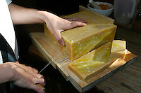 slicing hand made soap into pieces