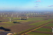 Nederland, Flevoland, Flevopolder, 20-01-2011; de windmolens op het erf bij de boerderij en in het veld vormen een windmolenpark..Wind mill park in the polder of Flevoland. .luchtfoto (toeslag), aerial photo (additional fee required).copyright foto/photo Siebe Swart