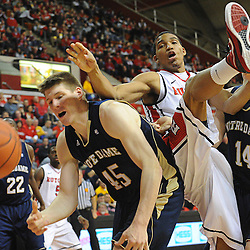 Rutgers Scarlet Knights guard/forward Derrick Randall (15) comes down awkwardly on Notre Dame Fighting Irish forward Jack Cooley (45) as a loose ball bounces away during Big East NCAA action during Rutgers' 65-58 victory over Notre Dame at the Louis Brown Athletic Center in Piscataway, N.J.