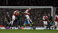 Football - 2018 / 2019 UEFA Europa League - Quarter Final, First Leg Arsenal vs. Napoli <br /> <br /> Nacho Monreal (Arsenal FC) heads towards goal unchallenged at The Emirates.<br /> <br /> COLORSPORT/DANIEL BEARHAM