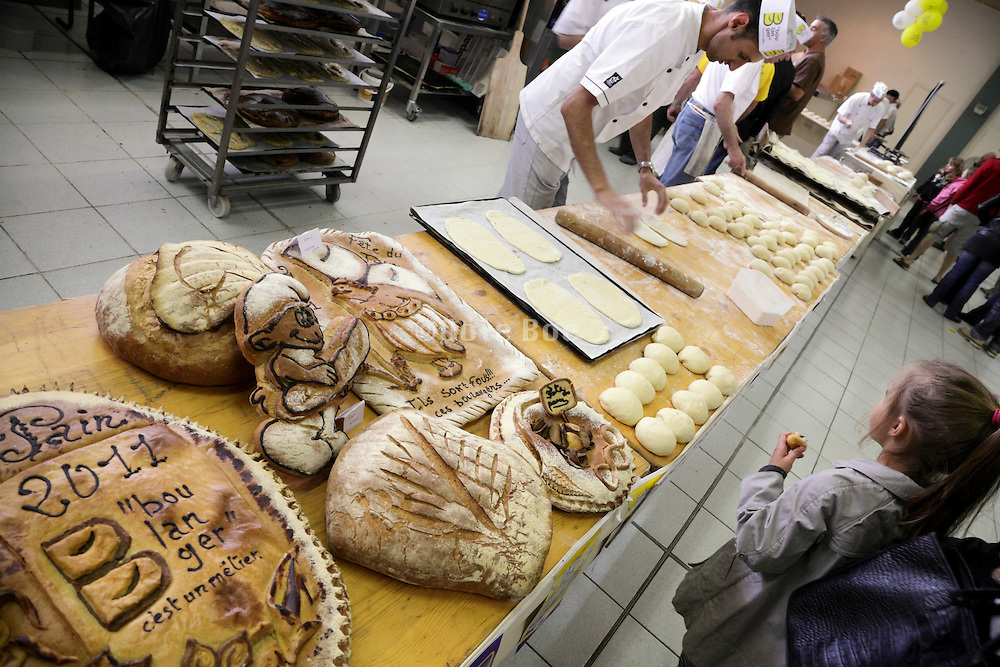 old style hand rolled bread dough preparing at a bakery trade show France