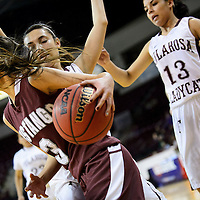 031114  Adron Gardner/Independent<br /> <br /> Ramah Mustang Jordyn Lewis (3) drives baseline through the Tularosa Wildcats during the state high school basketball tournament at the Santa Ana Star Center in Rio Rancho Tuesday.