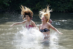 June 21, 2017 - London, UK - MELANIE LEPPARD and SAMMI LORD jump into Hampstead Heath Mixed Bathing Pond in north London as temperatures hit 34C and makes it the hottest UK June day since 1976. (Credit Image: © Tolga Akmen/London News Pictures via ZUMA Wire)