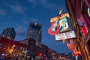The neon lights of Lower Broadway in Nashville illuminate the entertainment district famous for its country music.