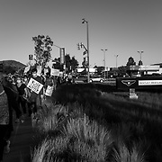 Protesters make their way past a Bentley dealership while protesting in support of Black Lives Matter on the day George Floyd was buried.