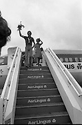 1983-15-08.15th August 1983.15-08-1983.08-15-83..Photographed at Dublin Airport..On top of his game:..Gold medalist Eamonn Coughlan waves as he emerges from an Aer Lingus flight on his return home from the World Athletic Championships in Helsinki, Finland