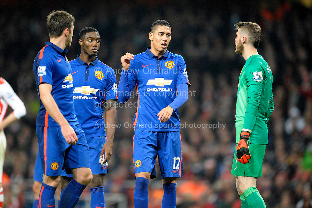 Chris Smalling of Manchester United having a discussion with David De Gea of Manchester United during the second half. Barclays Premier league match, Arsenal v Manchester Utd at the Emirates Stadium in London on Saturday 22nd November 2014.<br /> pic by John Patrick Fletcher, Andrew Orchard sports photography.