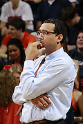 CHARLOTTESVILLE, VA- NOVEMBER 29: Virginia assistant coach Jason Williford watches a play during the game on November 29, 2011 at the John Paul Jones Arena in Charlottesville, Virginia. Virginia defeated Michigan 70-58. (Photo by Andrew Shurtleff/Getty Images) *** Local Caption *** Jason Williford